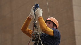 Industrial climber climbing rope. Facade Cleaning. Mountaineering gear stock video