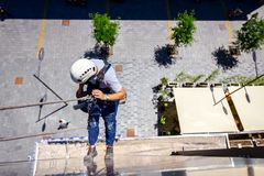 Free Industrial Climber Is Washing, Cleaning Facade Of A Modern Office Building Stock Images - 114550424