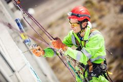 Industrial climber during winterization works Royalty Free Stock Image