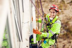 Industrial climber during winterization works Stock Images