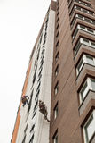 Industrial climbers climb on a facade of the building Stock Image