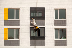 Industrial climbers climb on a facade of the building Royalty Free Stock Photography
