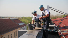 Industrial Climbers Preparing for Climbing Stock Photos