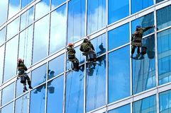 Industrial climbers wash windows of skyscraper Stock Image
