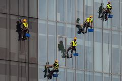 Industrial climbers washing windows in Romania Royalty Free Stock Photography