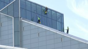 Industrial Climbers - Window washers clean facade of New Building stock footage