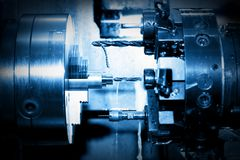 Industrial CNC drilling and boring machine at work. Close-up. Industry concept, blue tone Stock Photos