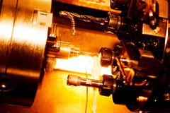 Industrial CNC drilling and boring machine at work. Close-up. Industry concept, red tone Stock Photos