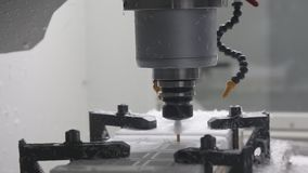 Industrial CNC Machine. Cutting out the detail out of white plastic material stock video