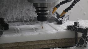 Industrial CNC Machine on a factory. Industrial CNC Machine cutting out the detail out of white plastic material stock video
