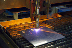 Industrial cnc plasma cutting of metal plate. Closeup Royalty Free Stock Images