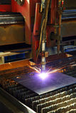 Industrial cnc plasma cutting of metal plate. Closeup Royalty Free Stock Photography