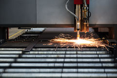 Industrial cnc plasma cutting of metal plate Stock Images