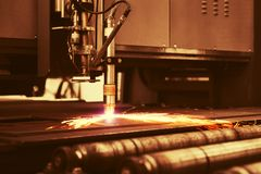 Industrial cnc plasma machine cutting of metal plate Royalty Free Stock Photo