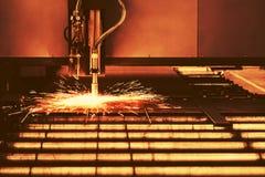 Industrial cnc plasma machine cutting of metal plate Stock Photos