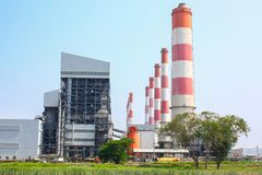 Industrial coal power plant with smokestacks and wetland stock image