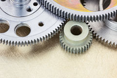Industrial cog wheels and metal gears background closeup. Royalty Free Stock Image