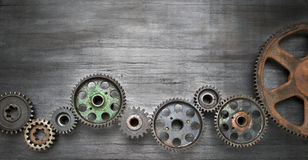 Industrial Cogs Technology Banner Background. Old Cogs on a rustic wood banner background royalty free stock photos