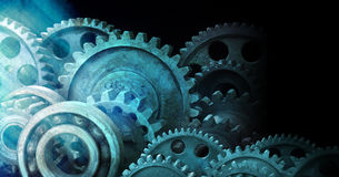 Industrial Cogs Gears Banner Background. An industrial background made of old metal cogs with a blue tone royalty free stock photo