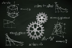 Industrial cogwheel on blackboard with math calculations  Stock Photos
