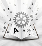Industrial cogwheel in opened book with flying alphabet concept Royalty Free Stock Photos