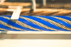 Industrial background with a coiled steel cable. stock images