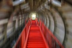 Industrial color background with red staircase. From inside one tube. Motion blur filter applied Stock Photo