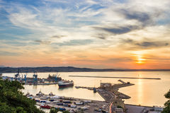 Industrial commercial port at sunset, Ancona, Italy Stock Image
