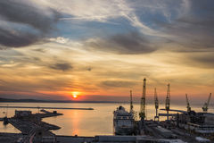 Industrial commercial port at sunset, Ancona, Italy Royalty Free Stock Images
