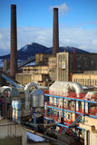 Industrial complex. With pipes and two chimneys Royalty Free Stock Photos