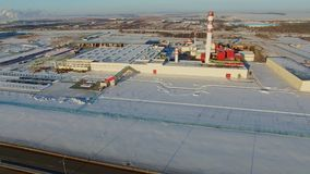 Industrial complex with chimney in winter aerial view stock video