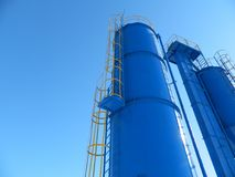 Industrial complex. In winter against the blue sky Stock Image