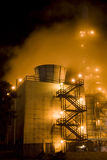 Industrial complex & Mist. An oil refinery in the United States with a series of foggy and smoky stacks. Industrial complex in an oil refinery Royalty Free Stock Photography