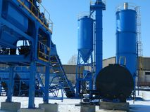 Industrial complex. In winter against the blue sky Royalty Free Stock Photography