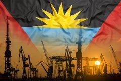 Industrial concept with Antigua Barbuda flag at sunset royalty free stock photos