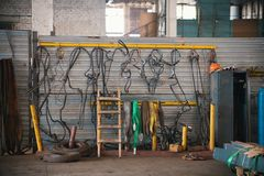 Industrial concept. Constructing lifting crane in the plant. Metal cables on the wall. Mid shot royalty free stock photo