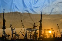 Industrial concept with Estonia flag at sunset royalty free stock photography