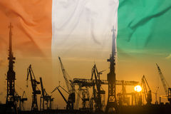 Industrial concept with Ivory Coast flag at sunset Stock Photo