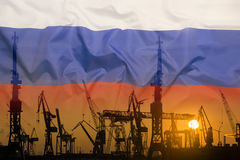 Industrial concept with Russia flag at sunset Stock Photography