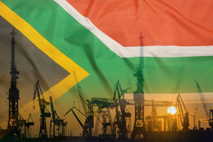 Industrial concept with South Africa flag at sunset Royalty Free Stock Photos