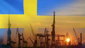 Industrial concept with Sweden flag at sunset. Silhouette of container harbor stock video footage