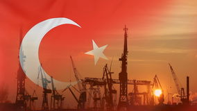 Industrial concept with Turkey flag at sunset. Silhouette of container harbor stock video