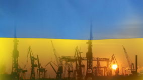 Industrial concept with Ukraine flag at sunset. Silhouette of container harbor stock footage