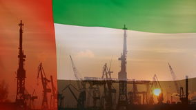 Industrial concept with United Arab Emirates flag at sunset stock video footage