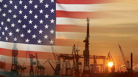 Industrial concept with USA flag at sunset. Silhouette of container harbor stock video footage