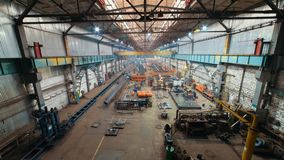 Industrial concept. A view from the bridge on construction site inside the manufacturing plate