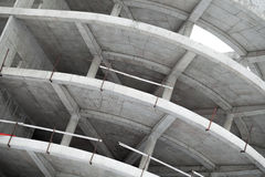 Industrial concrete building under construction. Abstract industrial round concrete building under construction royalty free stock images