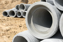 Industrial concrete drainage pipes stacked for construction. New tubes Stock Photo