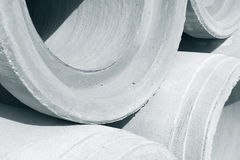 Industrial concrete drainage pipes stacked for construction. New tubes Royalty Free Stock Photo