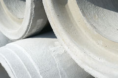 Industrial concrete drainage pipes stacked for construction. New tubes Royalty Free Stock Images